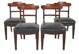 A set of six George IV mahogany and leather upholstered dining chairs