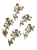 A set of five French gilt bronze five light wall appliques