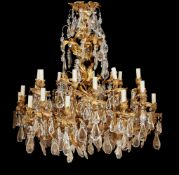 A fine French gilt bronze and cut glass hung twenty four light chandelier in Louis XV style