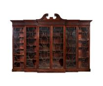 A George III style mahogany double breakfront bookcase
