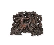 A Northern European, probably German, carved and stained oak misericord or ecclesiastical ornament,
