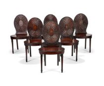 A set of six late George III mahogany hall chairs, circa 1790