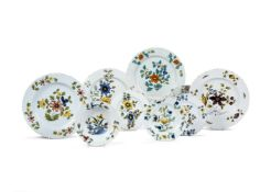 Eight various English delft plates and chargers of Fazackerly type, third quarter 18th century