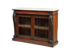 ϒ A pair of George IV rosewood and gilt-metal mounted side cabinets, in the manner of Banting