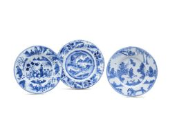 Three Dutch Delft/North German fayence blue and white chargers decorated in the Transitional style,
