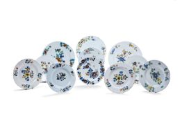 Eleven various English delft plates and chargers of Fazackerly type, third quarter 18th century