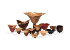 λ Bert Marsh (British, 1932-2011), a collection of thirteen various turned wood vessels