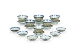 A set of six Chinese 'Linglong' rice bowls, covers and stands, late 19th century