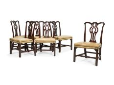 A set of six George III carved mahogany dining chairs, circa 1760
