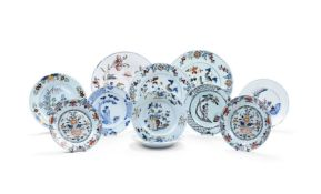 A selection of eleven English delft plates and chargers, third quarter 19th century