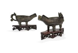 A pair of Chinese ritual bronze archaistic pouring vessels, Yi, Ming Dynasty, 17th century