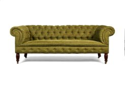 A Victorian walnut and button-upholstered chesterfield sofa
