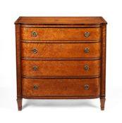 ϒ A late George III 'bird's eye Maple' bow-front chest of drawers, circa 1810