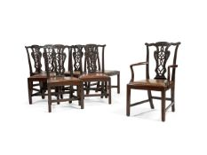 A matched set of seven George II style carved mahogany dining chairs, late 19th century