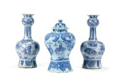 A Dutch Delft blue and white baluster vase and cover, circa 1700