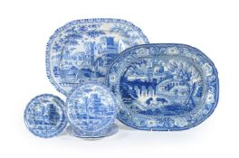 A large Staffordshire pearlware 'well and tree' meat dish printed in blue with cattle watering befo