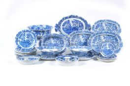 The remnants of a Henshall & Co. blue and white printed pearlware 'Castle & Bridge' pattern dinner s