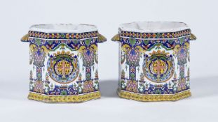 A pair of French fayence Rouen-style polychrome octagonal section bottle coolers