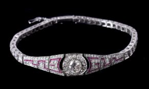 An early 20th century diamond and ruby bracelet