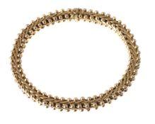 An 18 carat gold bracelet by Carlo Weingrill