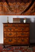 A Queen Anne walnut and feather banded chest of drawers, circa 1710