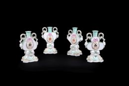 A set of four Meissen celadon-ground two-handled candlesticks modelled as a suit of cards, dated 187
