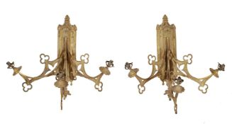 A pair of unusual Continental gilt metal three light wall appliques in Gothic Revival taste, circa 1