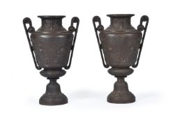 A pair of French cast iron urns in Neoclassical style attributed to Barbezat & Cie