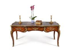 ϒ A Louis XV kingwood, tulipwood and gilt metal mounted bureau plat, circa 1770