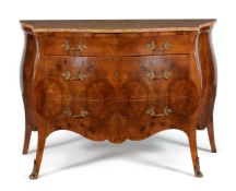 A pair of Continental figured walnut and gilt metal mounted serpentine commodes, in mid 18th century