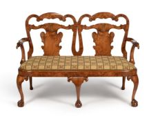 A walnut chair back settee, in George II style, 19th century