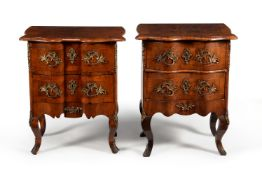 A matched pair of Continental walnut commodes, late 18th/early 19th century