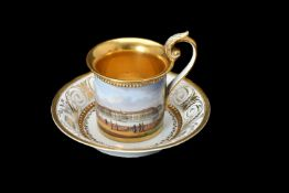 A Meissen Empire style topographical cabinet cup and saucer painted with a view of the Winter Palace