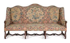 † A French walnut and needlework upholstered settee, 18th century and later elements