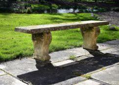A Regency carved stone garden bench