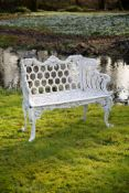 A white painted cast iron 'rose garden pattern' garden seat to a model by Carron & Co