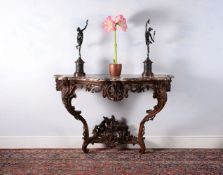 A Louis XV carved oak console table, circa 1735