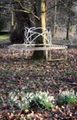 A Regency white painted wrought iron wirework tree seat