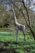 A large patinated metal garden model of a standing giraffe, late 20th century