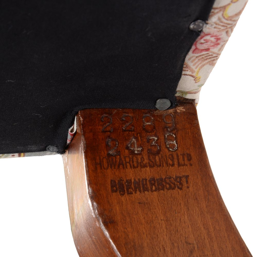 Lot 258 - A Victorian mahogany and upholstered sofa by Howard & Sons