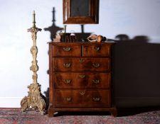 A George I walnut chest of drawers, circa 1725