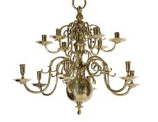 A companion pair of Dutch or English brass twelve light chandeliers, 18th century
