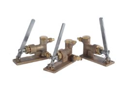A collection of three polished brass water feed pumps