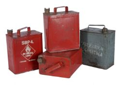 A collection of four metal petrol cans