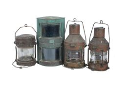 A collection of four copper ships navigation lamps