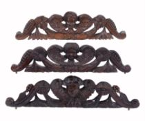 Three carved wood longcase clock pediment crest ornaments