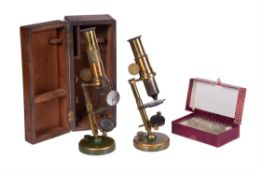 Two French brass student's portable microscopes, unsigned, late 19th century
