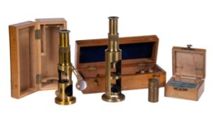 Two lacquered brass compound drum microscopes, both unsigned, mid to late 19th century