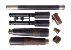 Two WWI military issue refracting telescopes and one other, various makers, early 20th century