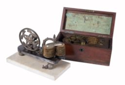 Two Victorian medical electromagnetic magnetos, one by W. Matthews, London, late 19th century